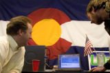 DM0323   Doug Young, left, and Don Weigel watch the results of the Iowa Caucuses at the Colorado...