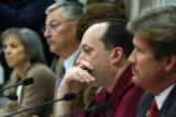 Members of the special House Committee listen to  Rep. Douglas Bruce (cq) testify at the state...