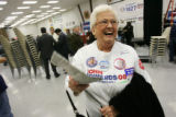 Edwards supporter Carolyn Fofi laughs after an appearance by Democratic presidential candidate...