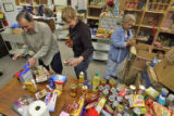 Food Bank Magager Rodolfo Gallegos (cq) and volunteers Joan Banko (cq) and Marie Gallegos (cq) ...