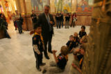Colorado Governor Bill Ritter gives cub scout Byron Liu (CQ), 7, a pat on the back after answering...