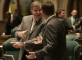 [010] State Representative Douglas Bruce shakes hands with State Representative Sean Mitchell...