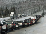 Oncoming eastbound traffic on I-70 east of the Eisenhower Tunnel speeds past westbound traffic...