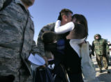 [281] Alison Marien (cq) gives her husband Capt. Paul Marien a big welcome home kiss moments after...