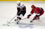 CANESSENS16.SP.102405.CCS--- The Canes captain Rod Brind'Amour, right, battles the Sens captain...