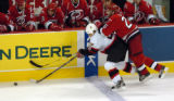 CANESSENS20.SP.102405.CCS--- The Canes Erik Cole, 26, rides the Sens Vaclav Varada, 26, to the ice...