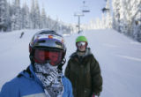 Students Aaron Blunk, left and Max Darsonvow listen to their coach as they ski the terrain park at...
