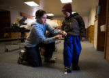(Leadville, Colo., Jan. 6, 2008) Tegan Owen attaches a lift ticket to the ski pants of her son,...