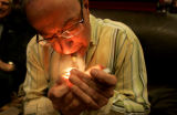 0180 Tim Engelhart, 56, of Centennial, enjoys a Bolivar cigar at Stanley Papas CIgars in Greenwood...