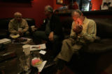 0185 Tim Engelhart, 56, right, of Centennial, enjoys a Bolivar cigar at Stanley Papas CIgars in...