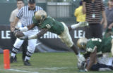 Carson 12-15-07: St.Bonaventure running back Darrell Scott leaps for a touchdown against Central...