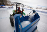 (Avon, Colo., Jan. 19, 2008) Joe Histed smooths the ice on a rink with a small Zamboni pulled by a...