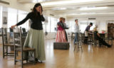 Beth Clayton, far left,  in the role of Carmen, with other actors during ehearsal of Opera...
