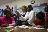 (From left-right )-Maya Carter (cq), 4,  makes a face as teacher Carol Kobobel looks with delight...