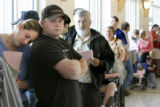 (L-R) Kim and Daniel Jensen wait in line at the Jefferson County Elections Office in Golden...