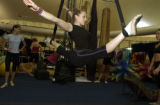 (DENVER, Colo., June 1, 2004) Irina Naumenko, russian aerilaist, stretches backstage to a seeming...