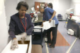 Denver Election officials count  ballots at the Denver Election Commission at 220 W. 14th Street...