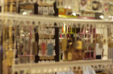 A shopper looks at jewelry on a cart in the Aurora Mall on Monday June 27, 2005, in Aurora. Mall...