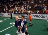 Denver, Colo., photo taken May 30, 2004-Colorado Crush quarterback, John Dutton, proudly carries...