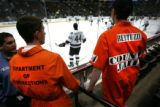 Randall Rayback, cq, 20, left and Derek Staudt, cq, 19, right, both of Arvada taunt Todd Bertuzzi...