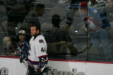 An Avalanche fan taunt Todd Bertuzzi during a skate around before a game against the Avalanche at...