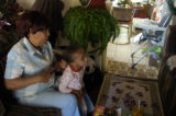 Ruth Evans brushes D'Neah  King's hair Wednesday, October 26, 2005 in her Denver home.  Evan's has...
