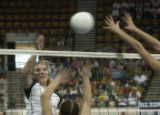 (Lt. to Rt.)  Mountain View High School's Karyn DenBoer number 4 blocks Glenwood High during the...