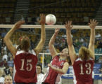 (BACKGROUND CENTER THE FOREGROUND Lt. to Rt.) Otis High School's Melyssa Davis number 5, is...