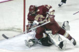 Denver's Tom May collides with UND goalie Jordan Parise during the second period Friday in Grand...