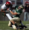 CODZ103 - San Diego State wide receiver Chazeray Schilens, left, struggles after catching a pass...