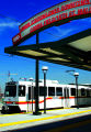 "An RTD light rail car takes a test run on the new ""C"" line portion of the RTD Light Rail..."