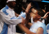JPM0273 Denver Nuggets Dermarr Johnson, #3, high-fives teammate Andre Miller during introductions...