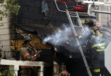 A single home blaze in which no one was injured in the neighborhood of Green Valley Ranch in...