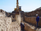 Geologists began digging a 400-foot-long trench Friday to determine if a 95-mile scar across the...