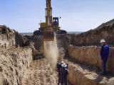Geologists began digging a 400-foot-long trench Friday, June 17, 2005 to determine if a 95-mile...