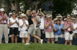 The crowd applauds Annika Sorenstam as she takes a walk up to the 18th green.  She finished 12...