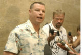 Robert Simonich, brother-in-law of Bruce Vanderjagt,  speaks outside of  Denver County court on...