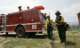 Wildland Firefighters from the Carbondale Fire Protection district keep their eyes on hotspots in...