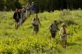 A group of Over The Hill Gang club members head out on a hike Saturday morning June 25, 2005 in...