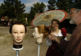 Rocky Mountain News reporter Erika Gonzalez, left to right, playing Contessa Fiona of Romania, ...