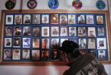 U.S. Marine Corps veteran George Autobee (cq) looks at a wall of photos of members of the Mile...