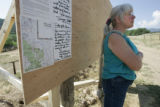Kelley Barnes (cq) from  Greenwood, pauses at a map of  the burn zone around her Greenwood near...
