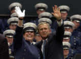 (COLORADO SPRINGS, Colo., June 2, 2004)  President George W. Bush poses with a graduate while...