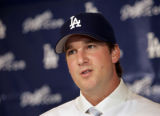 New Dodger pitcher Derek Lowe answers questions during a press conference at Dodger Stadium...
