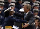 (COLORADO SPRINGS, Colo., June 2, 2004)  President George W. Bush hugs a graduate while attending...