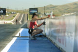 Morrison, CO July 11, 2005 Mindy Larum, 17, cleans up signage lining the track at Bandimere...