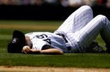 Colorado Rockies starting pitcher, Byung-Hyun Kim, lies dejected on his back after droping a line...