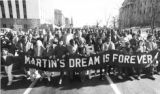 January 15, 1990. Hundreds march in fally from City Park to the Capitol steps Mon-day to honor...
