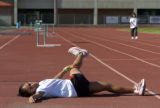 Zoila Gomez (cq) , who hopes to make the 2008 U.S. Olympic team in the marathon, limbers up on...