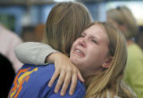 Sara Baird (cq), right, 23, of Colorado Springs, hugs her sister Kaitlin Baird (cq), 18, left,...